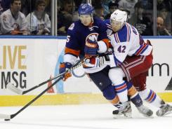 Rangers center Artem Anisimov challenges Islanders right wing P.A. Parenteau in the third period of the Islanders' eventual 4-3 shootout victory on Friday. Parenteau had two goals for the Islanders in the win.