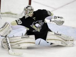 Penguins goalie Marc-Andre Fleury makes a save against the Rangers on Tuesday. Fleury already has 31 wins this season, only nine shy of his career high.