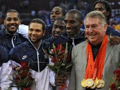 USA Basketball chairman Jerry Colangelo, right, hopes the Americans can duplicate the 2008 gold medal run when they travel to London this summer.