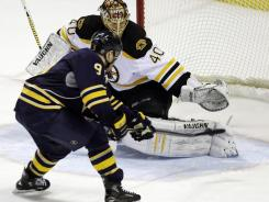 Sabres forward Derek Roy scores the game-winning goal on Boston Bruins goalie Tuukka Rask during their shootout Friday night.