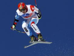 Switzerland's Didier Cuche takes to the air en route to winning the World Cup super-G in Crans Montana, Switzerland on Friday.