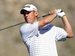 England's Lee Westwood hits his tee shot on the 16th hole during the third round of the World Golf Championships-Accenture Match Play Championship on Friday. Westwood beat Nick Watney to advance to the quarterfinals.