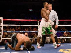 Adrien Broner, right, improved to 24-0 with his fourth-round knockout of Eloy Perez.