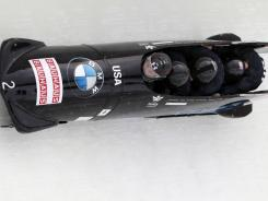 Pilot Steven Holcomb, front, has the USA-1 sled in first place halfway through the four-man competition.