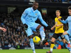 Mario Balotelli's 30th-minute tally propelled Manchester City to its 13th consecutive home win.