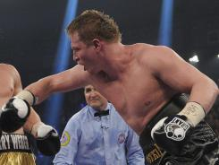 Heavyweight champion Alexander Povetkin, right, battles Marco Huck during the WBA title bout in Stuttgart, Germany. Povetkin won the match to remain undefeated.