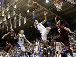 Duke's Austin Rivers (0) drives to the basket against Virginia Tech's Marquis Rankin (10) during the first half on Saturday. Duke won 70-65 in overtime.