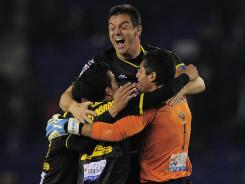 Levante players celebrate their victory that kept them one point ahead of Malaga for fourth place.