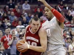 Jared Berggren scored Wisconsin's final five points — including a go-ahead 3-pointer with 31 seconds left — and the 15th-ranked Badgers beat No. 9 Ohio State 63-60 on Sunday.