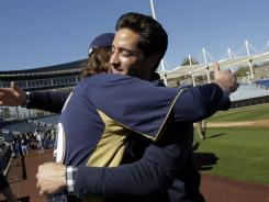 Brewers left fielder Ryan Braun, right, and closer John Axford embrace after a news conference in Phoenix on Friday, when Braun discussed winning his appeal of a 50-game steroid suspension.