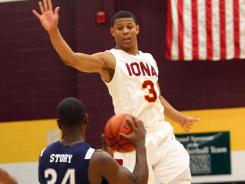 Nevada guard Malik Story looks to pass against Iona guard Scott Machado during a BracketBusters game on Feb. 18.