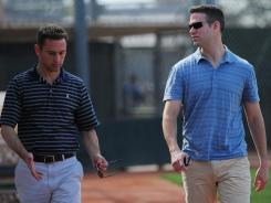GM Jed Hoyer, left, talks Thursday with President Theo Epstein at spring training. They plan to end the Cubs' World Series title drought that has lasted since 1908.