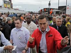 Mitt Romney makes his way through the crowd Sunday morning before the Daytona 500. He attended the prerace drivers meeting.