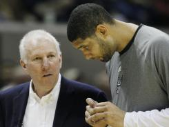 Can San Antonio Spurs coach Gregg Popovich, left, get one last title out of his veteran team, led by Tim Duncan?