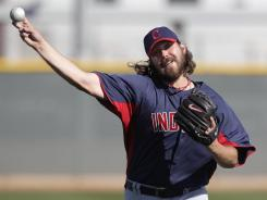 The Indians' Chris Perez strained a side muscle while throwing a bullpen session Sunday. Cleveland's closer will likely miss the beginning of the season.