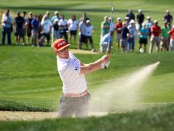 Hunter Mahan blasts out of a bunker on the 13th hole during the championship match of the World Golf Championships-Accenture Match Play Championship on Sunday in Marana, Ariz.