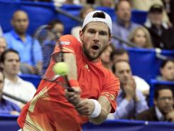 Jurgen Melzer of Austria lines up a forehand during his victory Sunday against Milos Raonic of Canada in the final of the Regions Morgan Keegan Championships in Memphis.