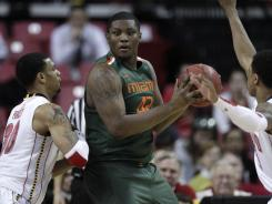 Miami center Reggie Johnson has been declared ineligible by the university after an investigation revealed members of his family received benefits not allowed under NCAA rules.