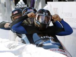 U.S. pilot Steven Holcomb, front, celebrates with pushers Justin Olsen and Steven Langton and brakeman Curtis Tomasevicz at the bobsled world championships.