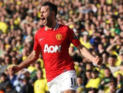 Manchester United's Ryan Giggs celebrates scoring the winning goal during the Premier League soccer match at Carrow Road, Norwich on Sunday.