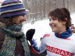 Katie Uhlaender, right, reacts with her mother Karen after winning the women's skeleton world championships in Lake Placid, N.Y., on Friday.