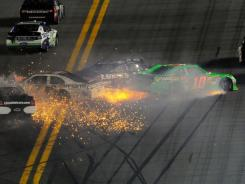 Danica Patrick (green No. 10 car) crashes, along with Jimmie Johnson, David Ragan and Kurt Busch on the second lap of the Daytona 500.