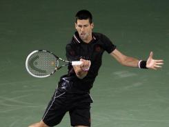 Novak Djokovic of Serbia lines up a forehand during his victory Monday against Cedrik-Marcel Stebe of Germany.