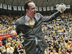 Gregg Marshall cuts down the nets and celebrates after his Wichita State squad clinched the Missouri Valley Conference regular season title.