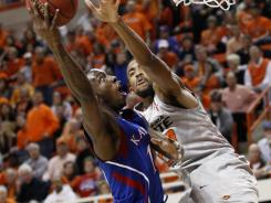 Tyshawn Taylor, left, poured in a game-high 27 points to lead Kansas to its seventh win in a row.