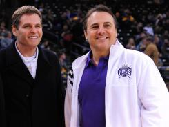 Joe Maloof, left, and Gavin Maloof, right, owners of the Sacramento Kings, reached a tentative deal with the city Monday to keep the NBA team in California's capital.