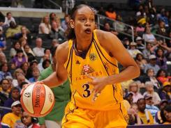 Tina Thompson, 37, is an eight-time WNBA All-Star and also won Olympic gold medals for the U.S. in 2004 and 2008.