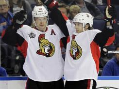 Ottawa's Jason Spezza, left, and Erik Karlsson are having better-than-expected seasons.