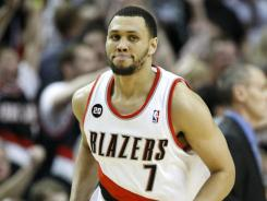 "Brandon Roy, shown April 23, says he might play again. ""I've been doing some treatment,"" he says, ""and I'm trying to leave the window open to returning to basketball."""