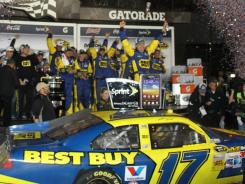 Matt Kenseth celebrates in Victory Lane after winning the Daytona 500 just before 1 a.m. Tuesday morning.