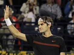 Roger Federer waves to the crowd after defeating Micheal Llodra Tuesday in the first round of the Dubai ATP Tennis Championships.
