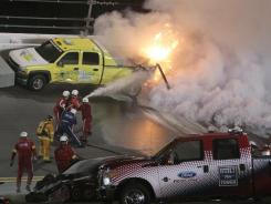 Emergency workers put out a fire on a jet dryer during Monday night's Daytona 500 that spilled into Tuesday.