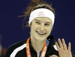 Katherine Reutter of the United States smiles after the award ceremony for the women's 1,000-meter speedskating event at the ISU World Cup in Shanghai on Dec. 11, 2011.