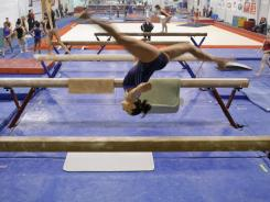 Aly Raisman works out on the balance beam at the U.S. Olympic training center on Jan. 20 at the Karolyi Ranch in New Waverly, Texas.