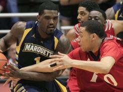 Marquette guard Darius Johnson-Odom (1) is pressured by Cincinnati guard Jeremiah Davis III in the first half in Cincinnati.