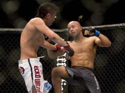 Demetrious Johnson, right, fighting Miguel Torres in 2011, and three others are vying for spots in the final of UFC's first flyweight tournament.