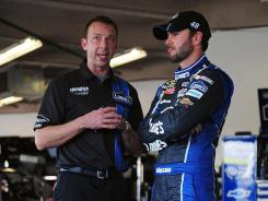 Chad Knaus, left, and Jimmie Johnson talk during a practice Feb. 24 Daytona International Speedway. Knaus won't be able to return to Johnson's pit box until late April.