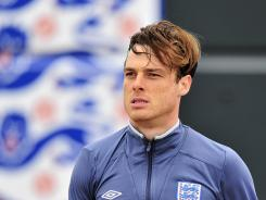 In a file photo taken on May 31, 2011, England midfielder Scott Parker attends a training session of the national team at London Colney, England. Parker will captain the England team against the Netherlands on Wednesday.