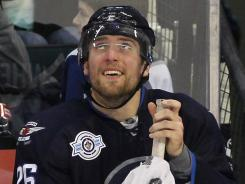 Winnipeg's Blake Wheeler smiles on the bench after scoring two goals against the St. Louis Blues last weekend.