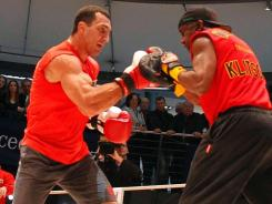 Wladimir Klitschko works the mitts with trainer Emanuel Steward, on Wednesday in Dusseldorf.