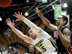 Colorado State's Kaipo Sabas (15) and UNLV guard Anthony Marshall go after a rebound during the first half in Fort Collins, Colo.