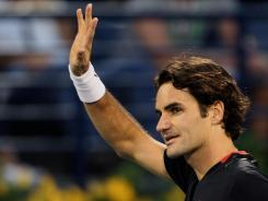 Roger Federer waves to the crowd after beating Mikhail Youzhny 6-3, 6-4 in the quarterfinals of the Dubai Championship on Thursday.