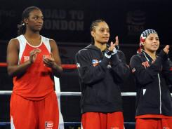 The U.S. Olympic Boxing team of Claressa Shields, Queen Underwood and Marlen Esparza (left to right) stand center ring after the Olympic boxing trials finals.