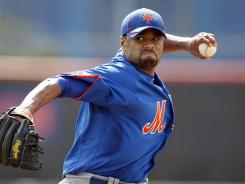 Mets' Johan Santana throws a live batting practice in Thursday's workout.