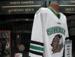Wearing jerseys sporting this word or this logo, or using either in any official way, during an NCAA postseason event could mean North Dakota would forfeit.