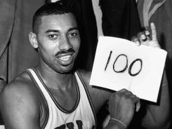 Wilt Chamberlain holds a sign spelling out the type of offensive stats he had on March 2, 1962.